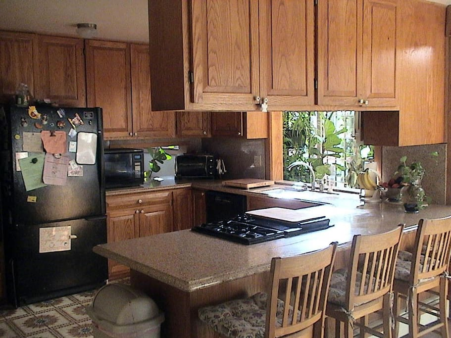 Fully stocked kitchen with Jenn Air range, instant hot water dispenser, pass throughs to dining room and family room.
