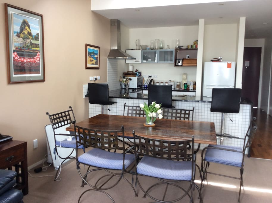 Kitchen dining area with breakfast bar and dining table