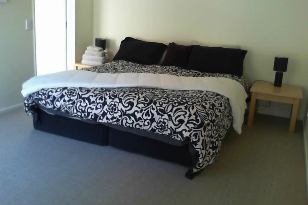 Main superking bed, also splits. Has ensuite and level access from the street and living areas