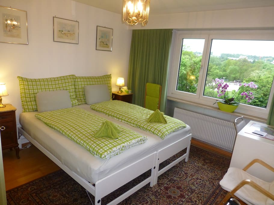 Twin-bed room with view of horse-racing course and St Jakob-Park Basel