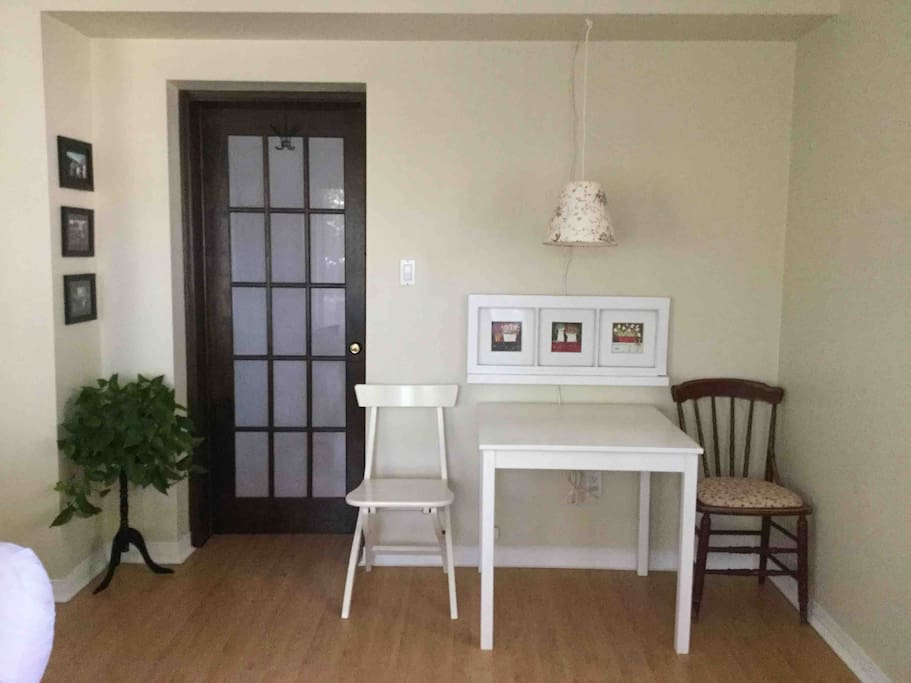 Table for two with coat hooks on the door.