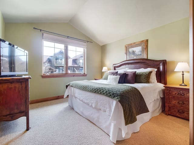 Master bedroom with king size bed and en suite bathroom featuring a steam shower