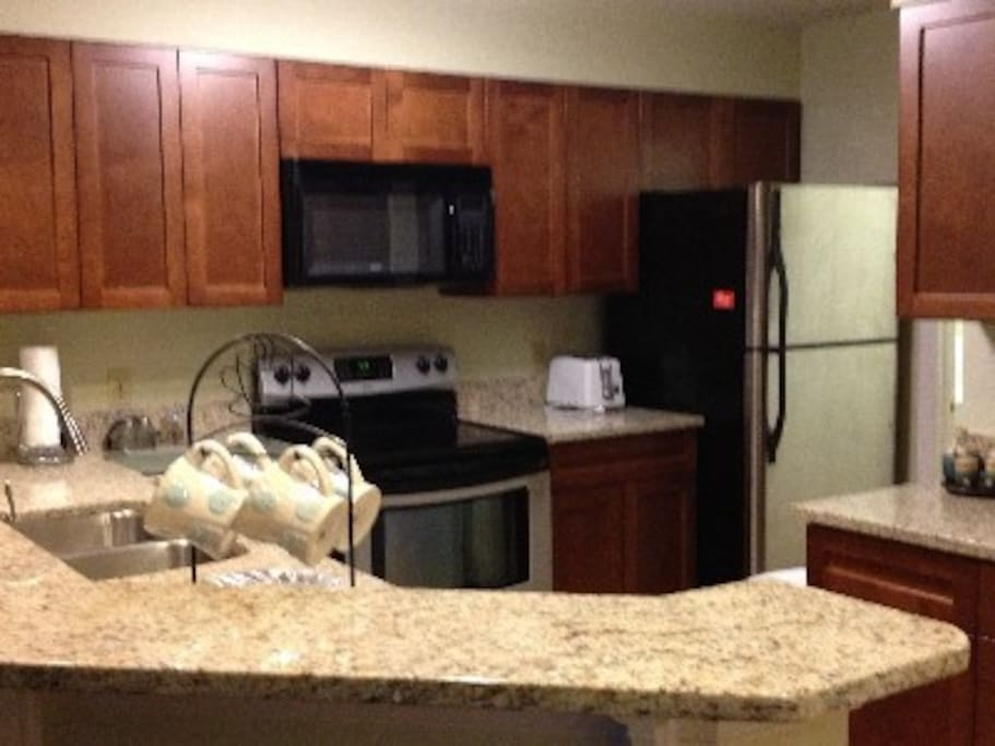 Beautifully appointed kitchen fully stocked, stainless steel appliances, Keurig, toaster, panini, crockpot. Starter set for dishwasher, washing machine, cleaning products provided.