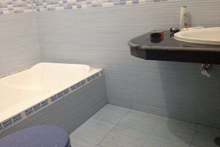 BATHROOM WITH BATHING TUB AND WESTERN SEAT