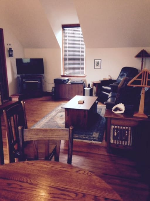 Hardwood floors, natural lighting, unique furnishings.