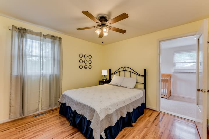 Queen bedroom with Lake view and attached Nursery/study