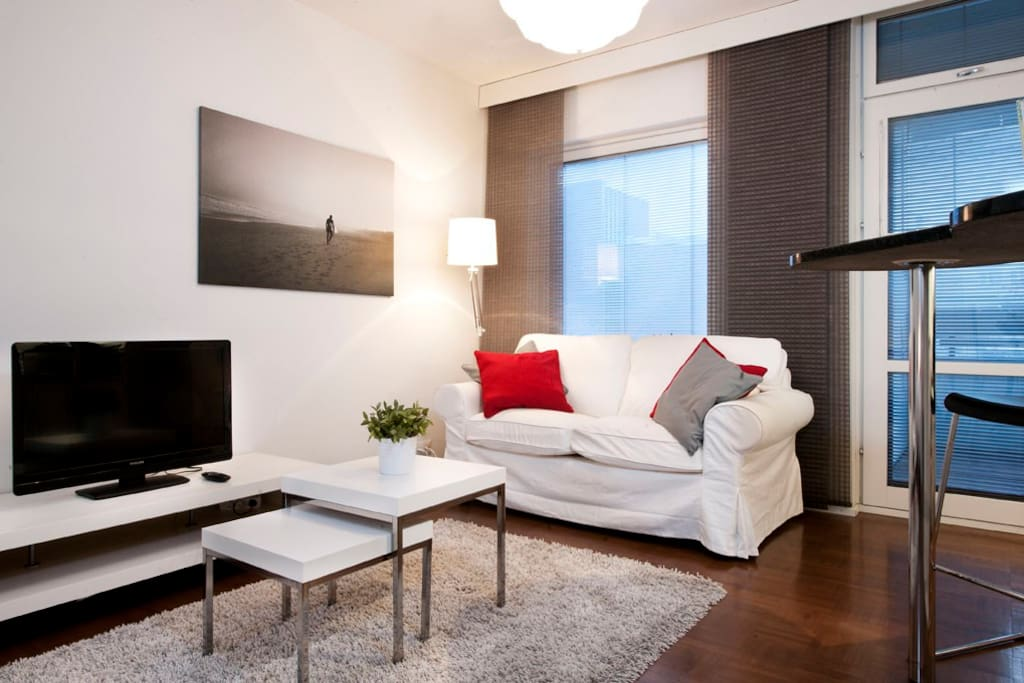 Comfortable living area with flat screen TV.