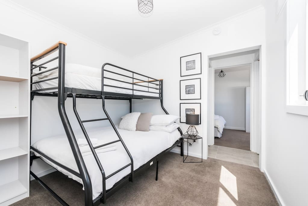 The walk through second bedroom comfortably sleeps 3 guests in a Double bed with Single above. All linen is supplied, is of beautiful quality is crisp & white.....