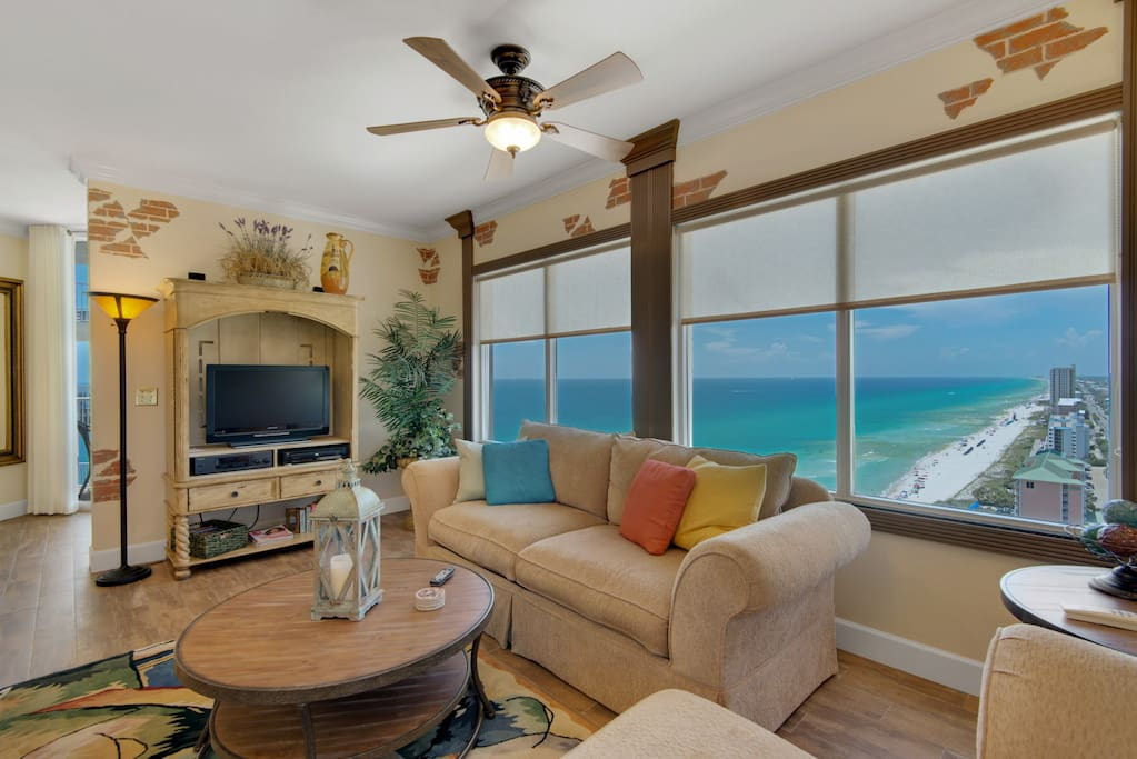 This corner condo has the most breathtaking views on the beach with a wall of windows