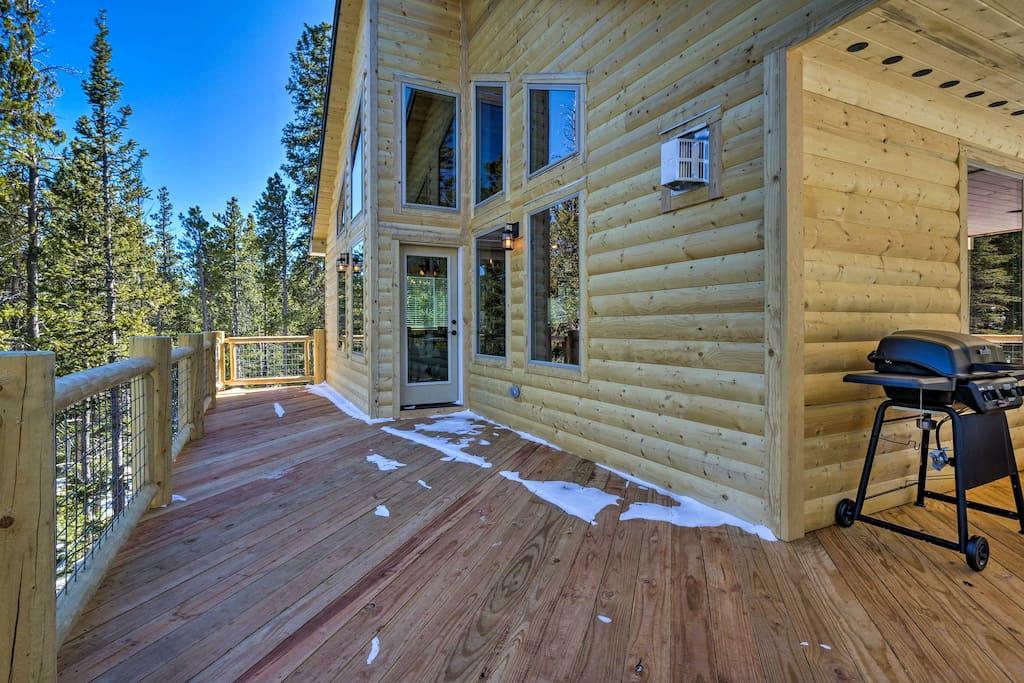 Step outside on the wraparound deck and enjoy the mountain views.