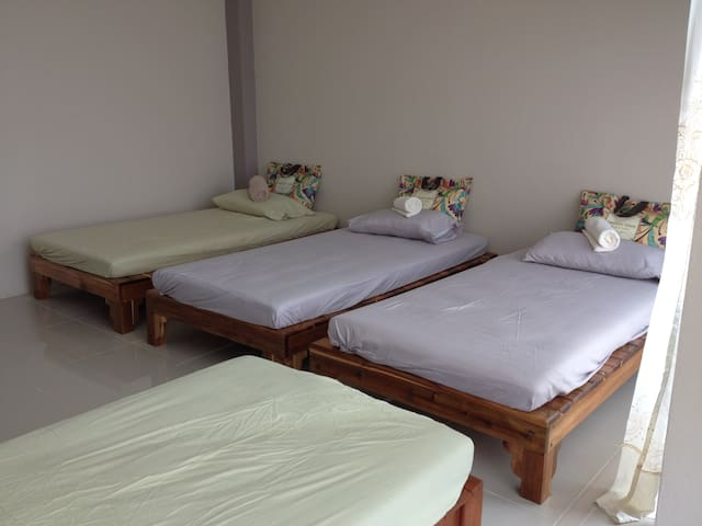 4 single beds in shared bedroom