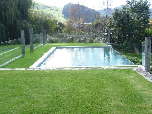 Infinity edge heated pool (In Summer)