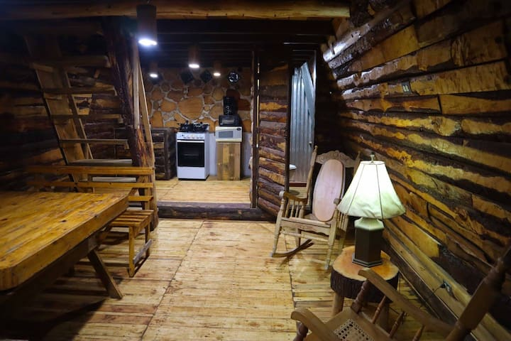 1st Floor. In the first floor guests can cook and enjoy a meal on the wood table