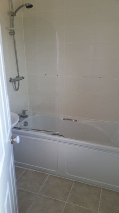 Gleaming bathroom with power shower