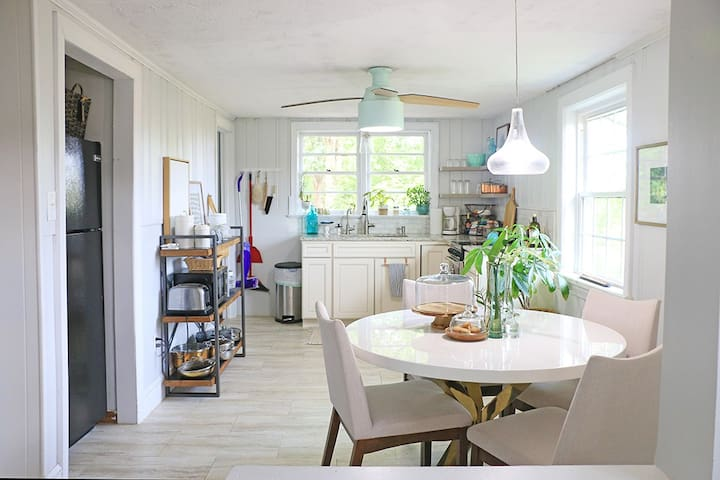 Kitchen + Eat-in Nook: Contains full sized refrigerator, small oven & stove, microwave, toaster, coffee maker.  Variety of pots and pans provided, measuring spoons & cups, cooking utensils, drink & dinnerware...everything you need for cooking!