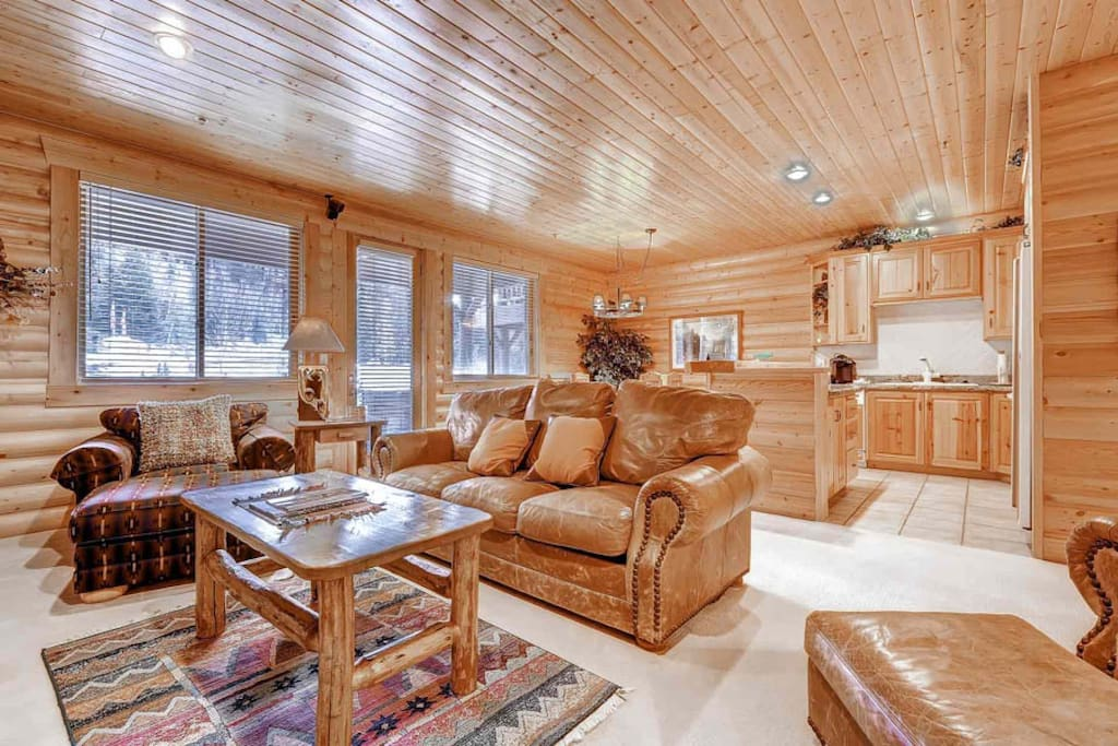 Classic mountain décor elements of interior log walls, hardwood ceilings & floors and custom lodgepole furniture. Large windows allow lots of light.