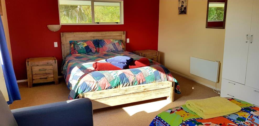 Upstairs north bedroom - queen bed.