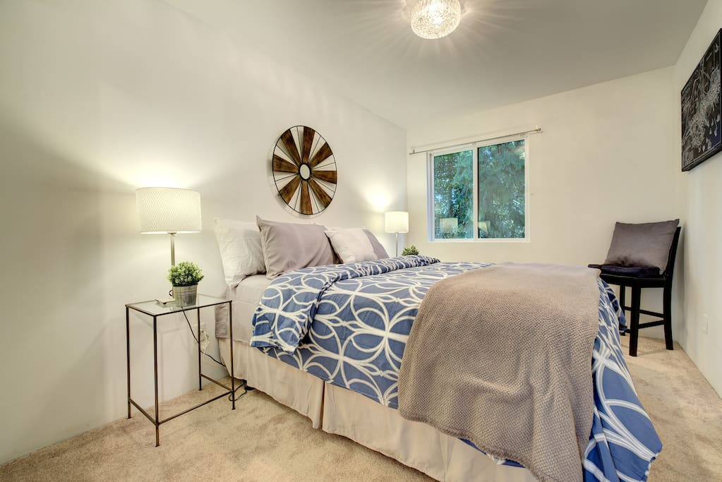 Private bedroom with queen bed and dresser.