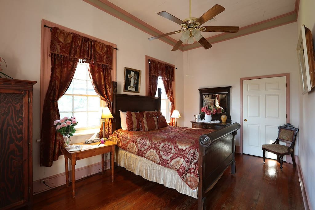 Antique Double Bed with windows overlooking Historic city of St. Martinville and St. Martin de Tours church, 3rd oldest church in Louisiana