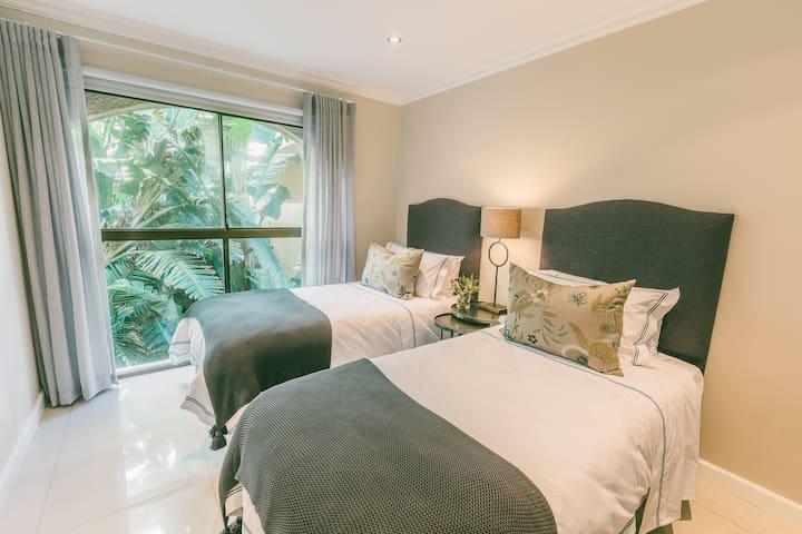 Twin beds garden view bedroom