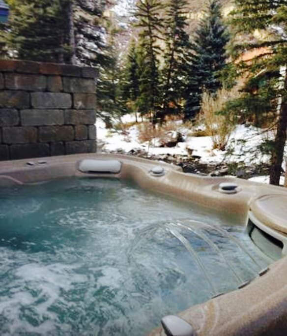 8 person saltwater hot tub uses less chlorine, and sits above the rushing river.
