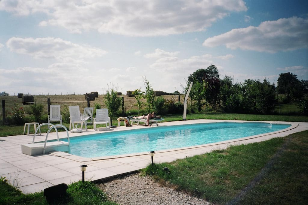 Swimming pool fenced area with sun loungers etc