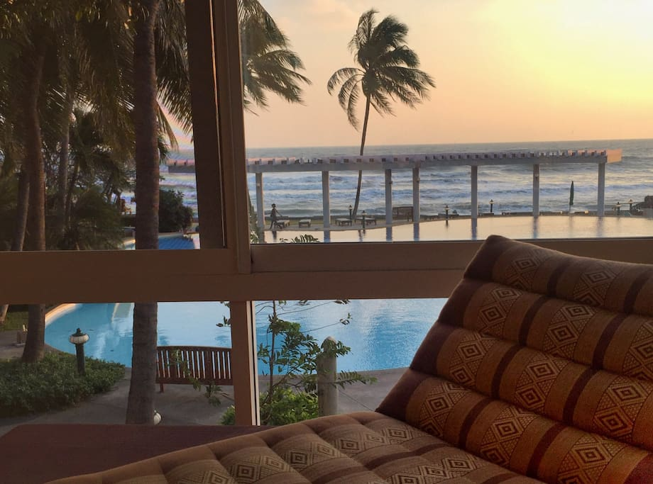 Living room sea view. Beautiful sunset from the living room overlooking at the ocean and the swimming pool.