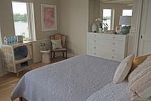 Bedroom 1 on first floor with lake view, queen bed