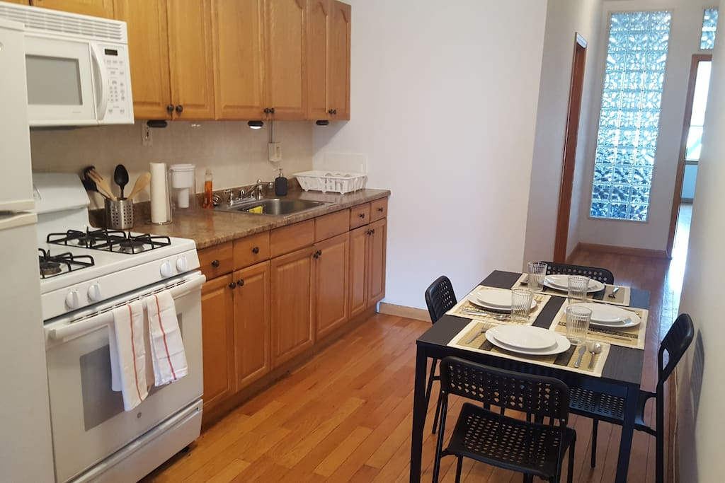 Full service kitchen with a large refrigerator, gas stove and range, lots of storage and all of the amenities to make you feel right at home. French press Bodum coffee pot, Brita water filter and everything you need to cook a great meal at home.