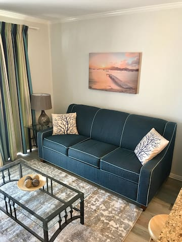 Relax on this sofa with recently updated flooring. This couch converts to a queen-size bed. Bedding for this is provided.