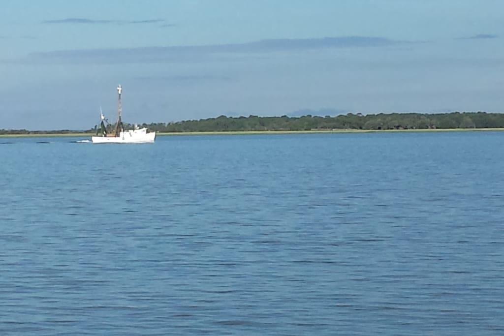 Shrimp boat passing Parris Island on the Beaufort River.