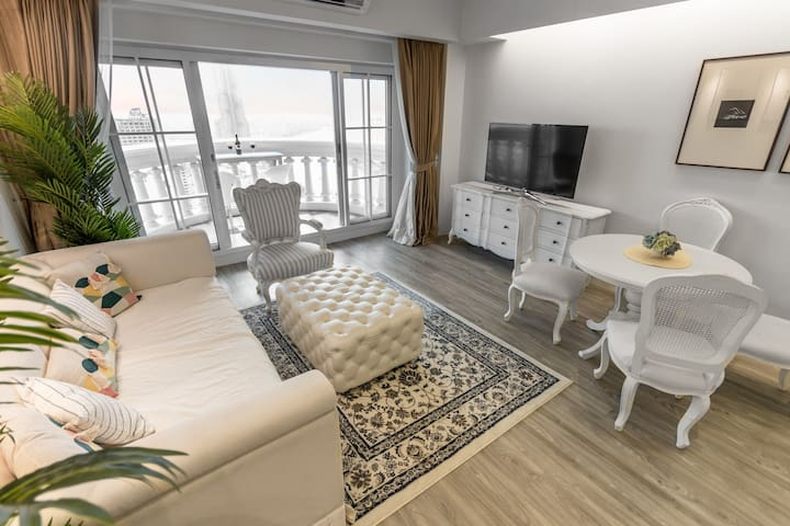 The living room with a big sofa (specially modified from a big single bed) and a dining table with 4 chairs, a big lounge chair, an internet TV. Our big private balcony is overlooking the Chao Phraya river, the River of King