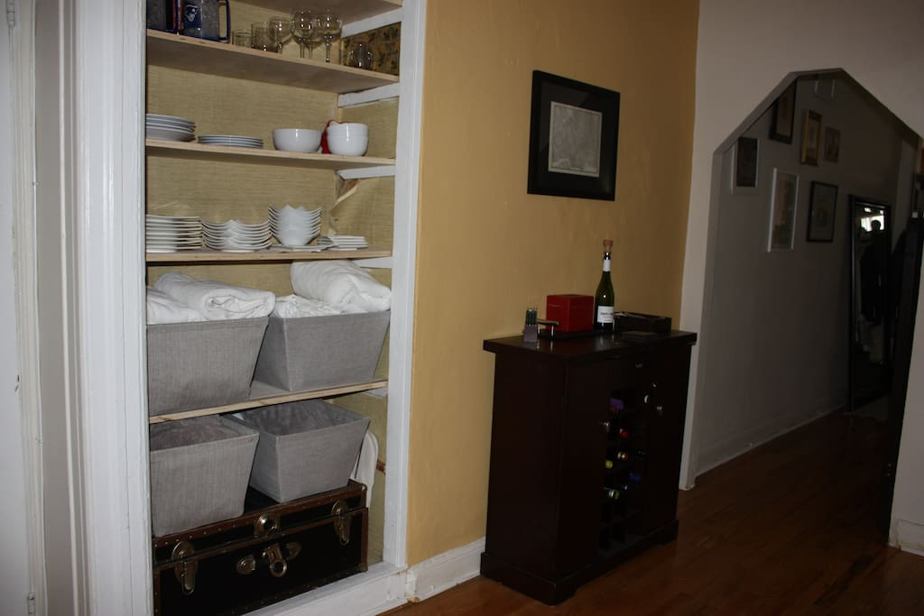 Bar cabinet and ample, exposed kitchen storage