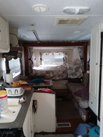 That's the kitchen area you have a microwave cooking stove you'll have a TV radio table and you'll see the queen size bed at the other end
