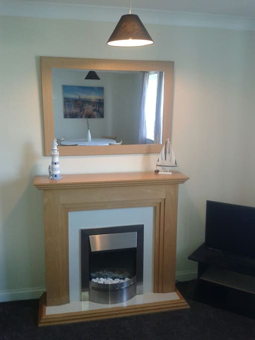 Ornamental fire place with mirror.