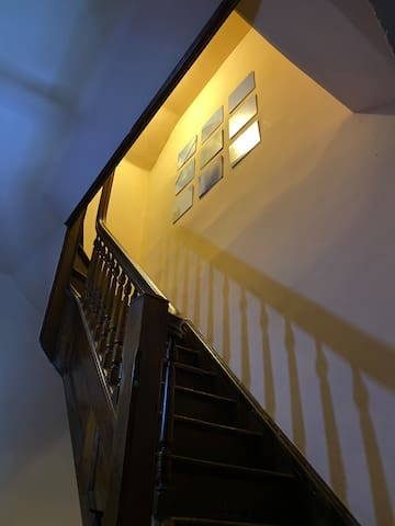 Looking up 3rd floor staircase