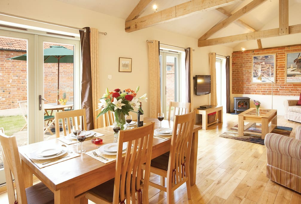 Ground floor: Large spacious sitting and dining room with three sets of French doors opening to west facing courtyard garden
