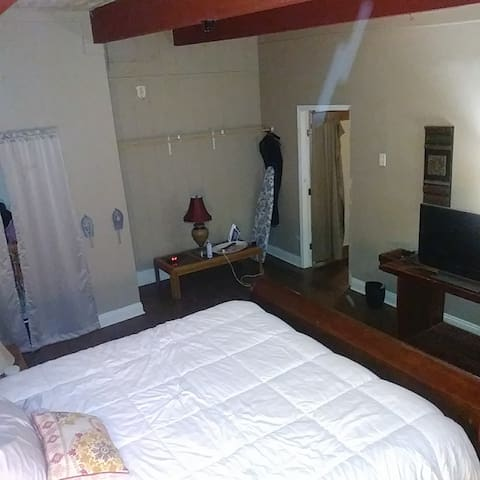 Master AirBnb with King size mattress bedroom, 42in cable TV, closet, private key lock door and extra clothes rack bar with personal A/C window unit in addition to new central heat & A/C installed.