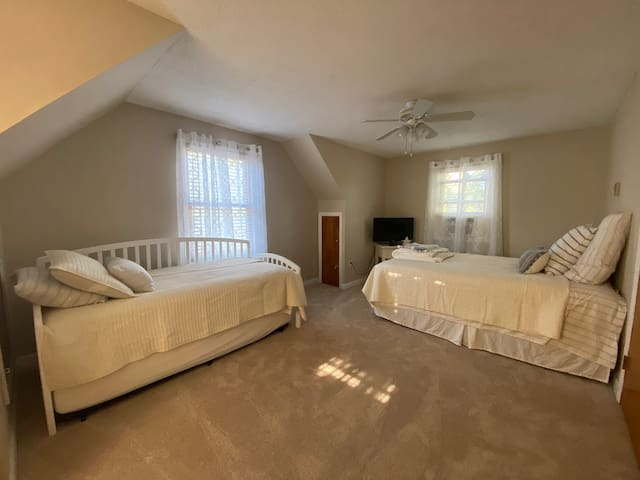Upstairs bedroom with a queen bed & twin trundle bed