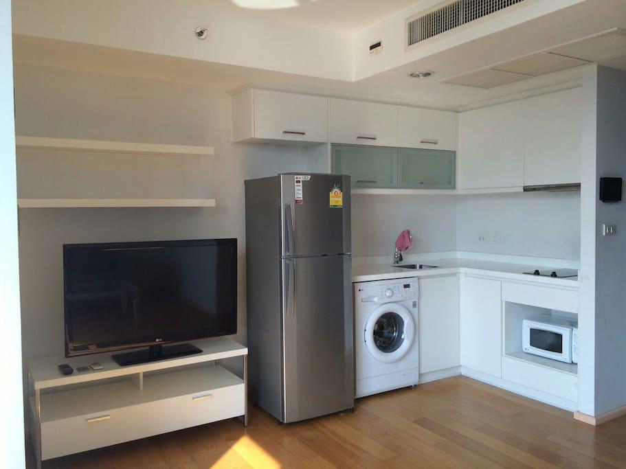 TV, Fridge, Washing machine, microwave and stove.