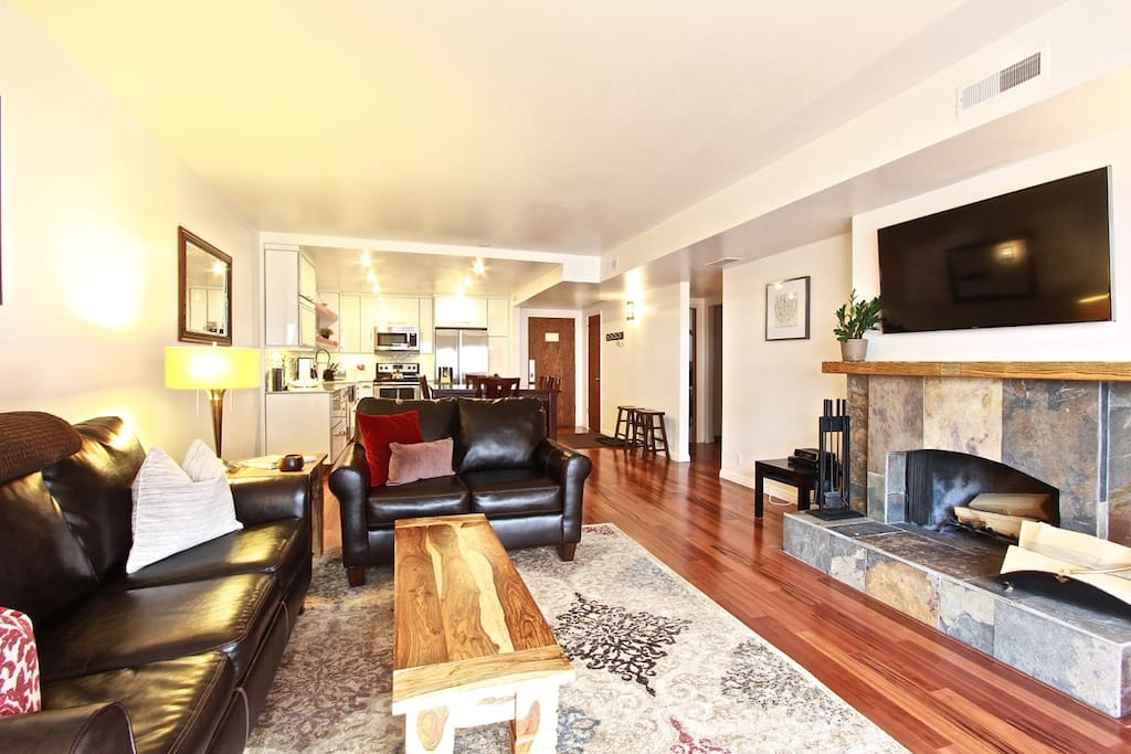 High end furniture and decor and a wood burning fireplace make our condo feel like home