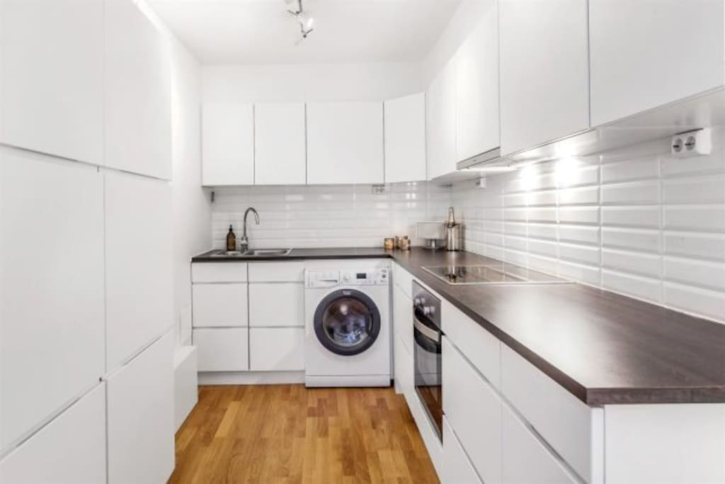 Kitchen with washing machine/dryer and dishwasher