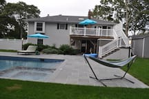 the back of the house, with the pool and hammock. You enter your apartment under the deck.