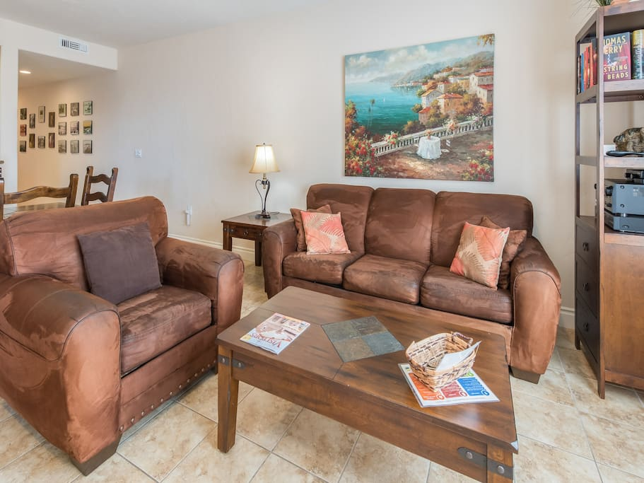 Kick back and relax on a comfy armchair and queen sleeper sofa in the living room.