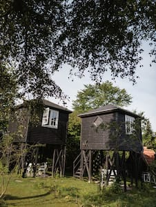 Small house on wooden pillars, cabin mX