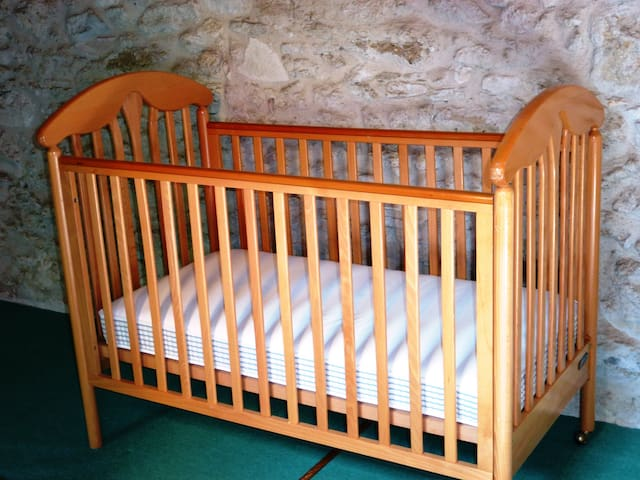 Nice wooden safe Cot available for your use (please let me know if you needed, so linen can be also be made available). High chair also available.