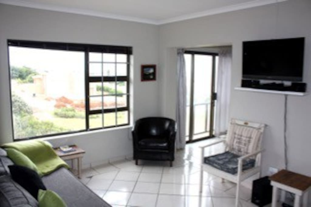 Sea view deck, indoor braai, dvd,             tv with dish, wi-fi, gated parking.