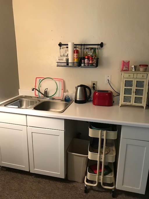 Kitchenette includes a coffee pot, toaster and tea kettle.