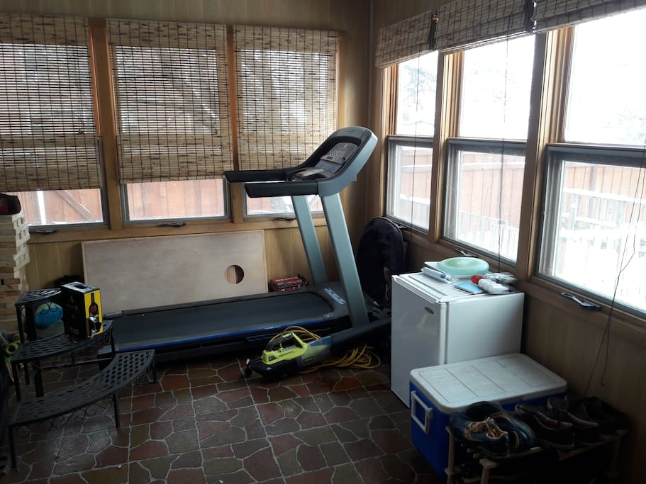 Treadmill overlooking our private fenced backyard, in case you're a runner!