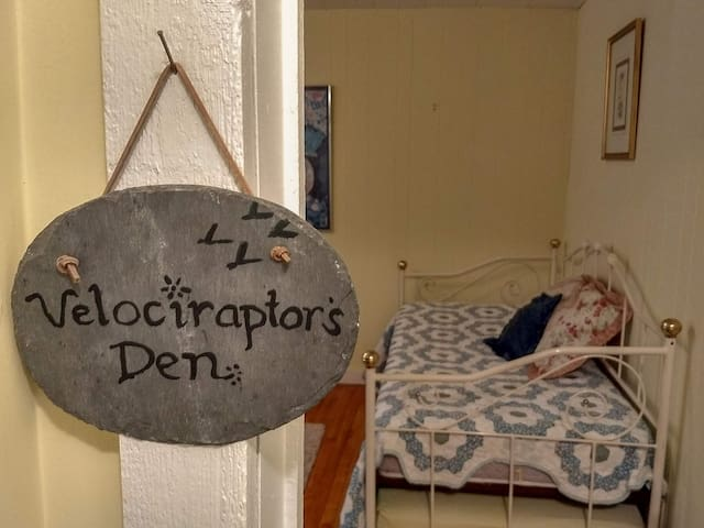 Velociraptor's Den has a full size bed with a day bed and trundle.